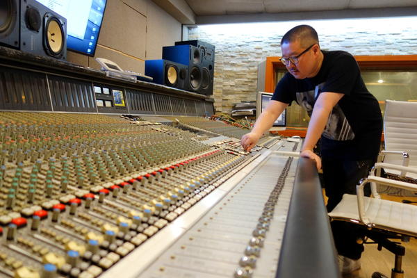 Asian music hitmaker Jae Chong, at work in a studio in Seoul. His work is all over Asian charts, but his passport is American.
