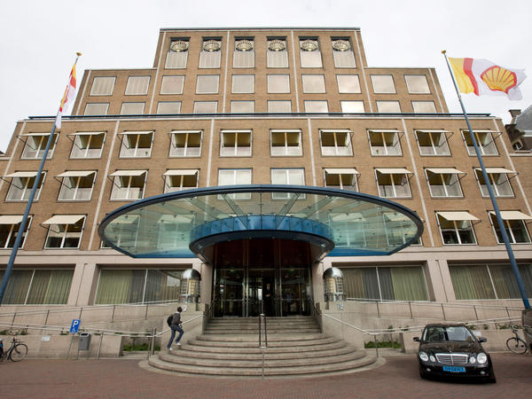 A flag bearing the logo of Royal Dutch Shell flies outside the head office in The Hague, Netherlands. The energy company said Wednesday that it has agreed to buy gas producer BG Group for $70 billion.