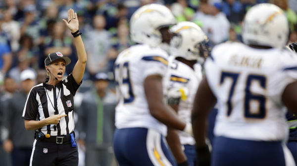 Sarah Johnson makes a call during the first half of an April 2014 preseason NFL football game between the Seattle Seahawks and the San Diego Chargers.