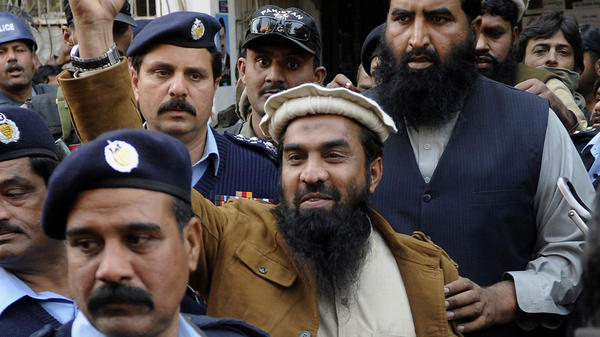 Zaki-ur Rehman Lakhvi, accused of plotting the 2008 Mumbai terror attacks, raises a fist outside a court in Islamabad, Pakistan, on Jan. 1. Lakhvi was released on bail Friday.