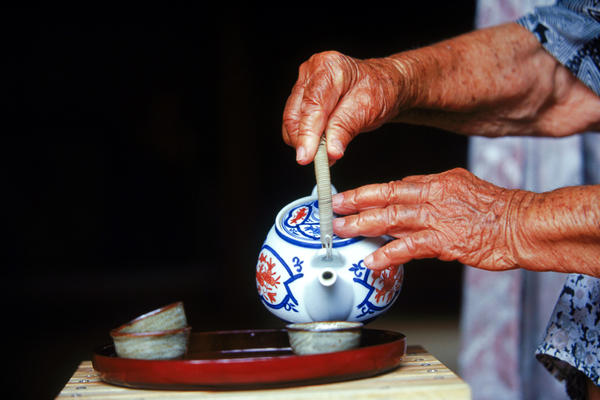 "Okinawans drink a special kind of green tea they call <em>shan-pien</em>, which translates to ""tea with a bit of scent."""