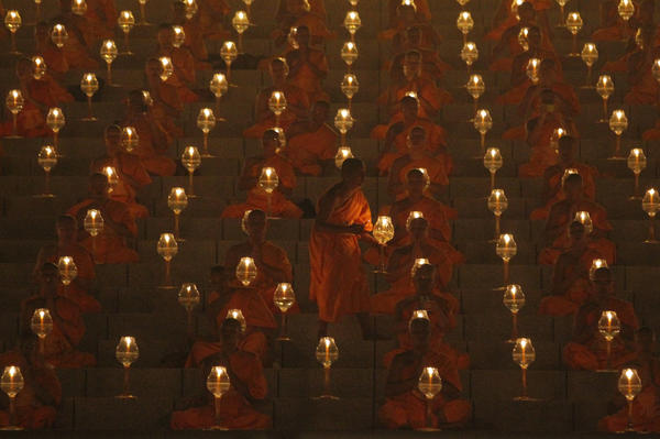 Thai Buddhist monks pray and gather at Wat Phra Dhammakaya temple to participate in Makha Bucha Day ceremonies on March 4. Ninety-four percent of Thais who participated in the survey said they considered themselves religious.