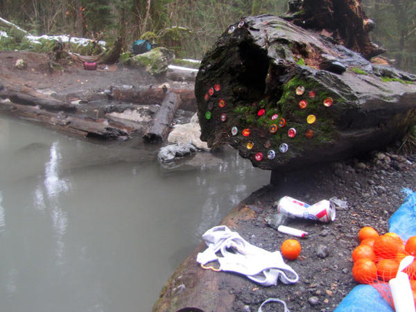 <p>A scene at Mount Baker Hot Springs, where litter and personal belongings can be found scattered on the ground.</p>