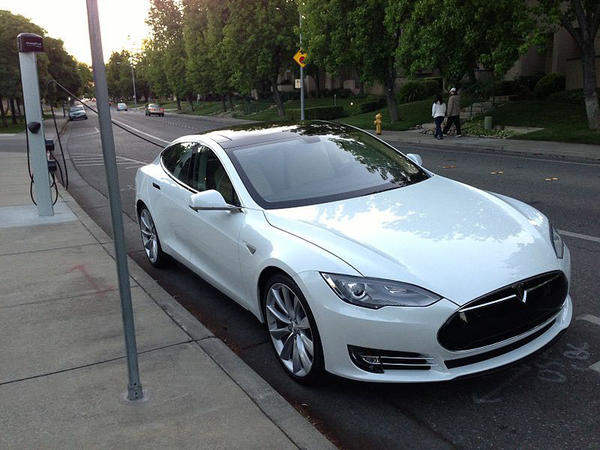 File photo of a Tesla Model S. Some states are starting to charge electric vehicle owners an extra annual registration fee.
