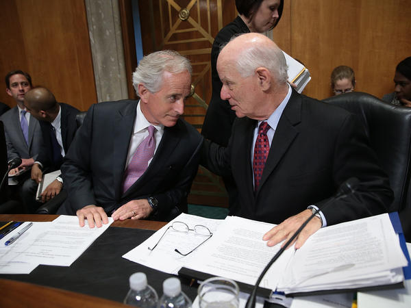 Senate Foreign Relations Committee Chairman Sen. Bob Corker (left) confers with ranking member Sen. Ben Cardin during a committee markup meeting on the proposed nuclear agreement with Iran.