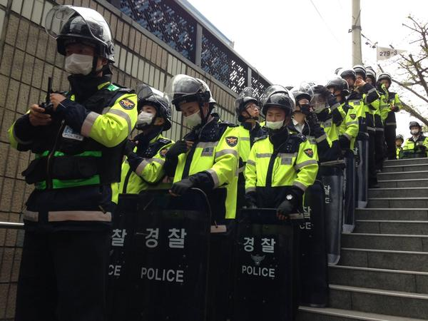 Riot police at the entrance to a subway station in central Seoul.