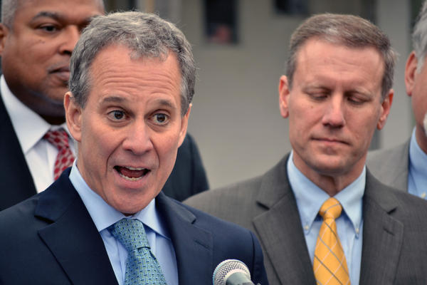 """New York Attorney General Eric Schneiderman stood in front of a vacant Syracuse home to renew his push for laws to reduce the number of """"zombie properties"""" stuck in foreclosure."""