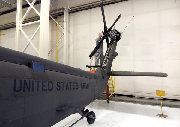 An aviation technician works on a UH-60 Blackhawk helicopter in the Washington National Guard Army Aviation Support Facility on Joint Base Lewis-McChord.