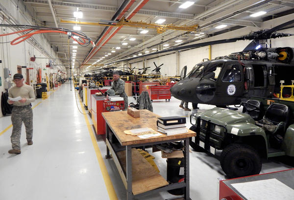 A view inside the Washington National Guard Army Aviation Support Facility on Joint Base Lewis-McChord in February. As Congress cuts $500 billion from the Defense Department budget, the National Guard and active Army are competing for the same dollars.