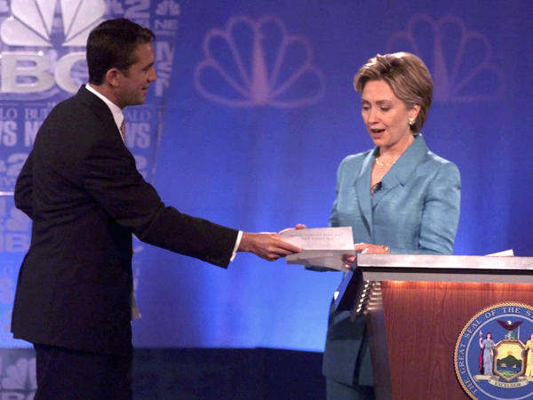 "During a 2000 Senate debate, Hillary Clinton's opponent Rick Lazio, R-N.Y., hands her a pledge to stop taking ""soft money."" But Lazio's tone was criticized for how not to debate a female candidate."
