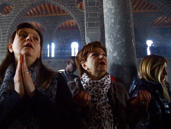 Armenian Christian women pray at St. Giragos Church in southeastern Turkey. The restored church, reopened in 2011, is the largest Armenian church in the Middle East.