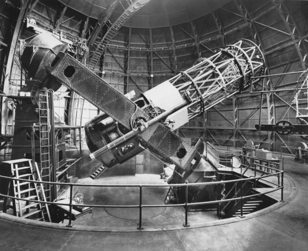 The Hooker 100-inch reflecting telescope at the Mount Wilson Observatory, just outside Los Angeles. Edwin Hubble's chair, on an elevating platform, is visible at left. A view from this scope first told Hubble our galaxy isn't the only one.