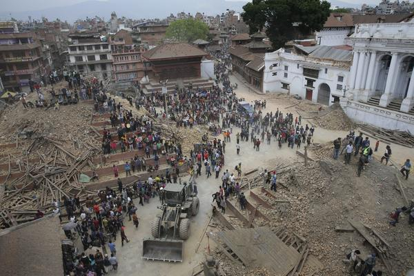 People search for survivors under the rubble of collapsed buildings in Kathmandu Durbar Square on Saturday.