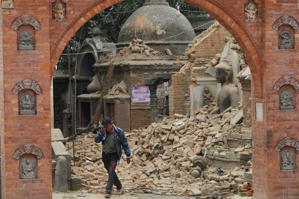 A Nepalese man cries as he walks through the earthquake debris in Bhaktapur, near Kathmandu, Nepal, Sunday.