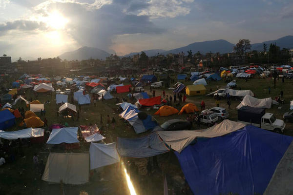 Nepalese residents set up tents in an open field at Chuchepati area in Kathmandu, Nepal.