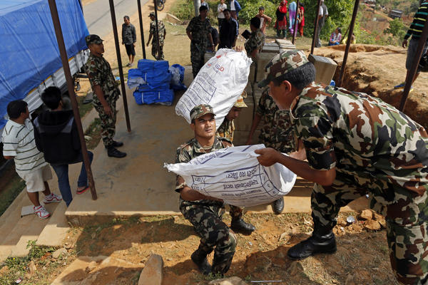 Nepalese soldiers load U.S. AID relief sacks at a staging area in Gorkha.