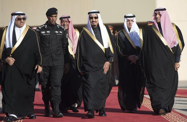 Saudi King Salman (center) appears alongside then-Crown Prince Muqrin bin Abdulaziz (third from left) and then-deputy Crown Prince and Interior Minister Mohammed bin Nayef (left) in January. Muqrin has since been pushed aside to make way for Mohammed.