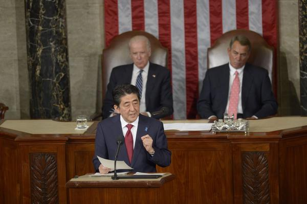 Japanese Prime Minister Shinzo Abe addresses a joint session of Congress at the U.S. Capitol in Washington, D.C., on April 29, 2015, as U.S. Vice President Joe Biden (left) and House Speaker John Boehner listen. (Saul Loeb/AFP/Getty Images)