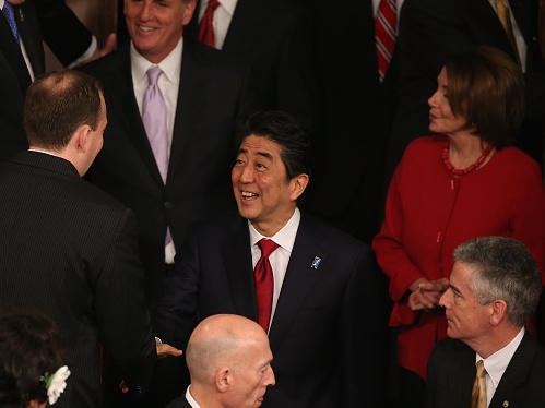 Prime Minister Shinzo Abe is greeted by members before speaking to a joint meeting of Congress, the first Japanese prime minister to do so.