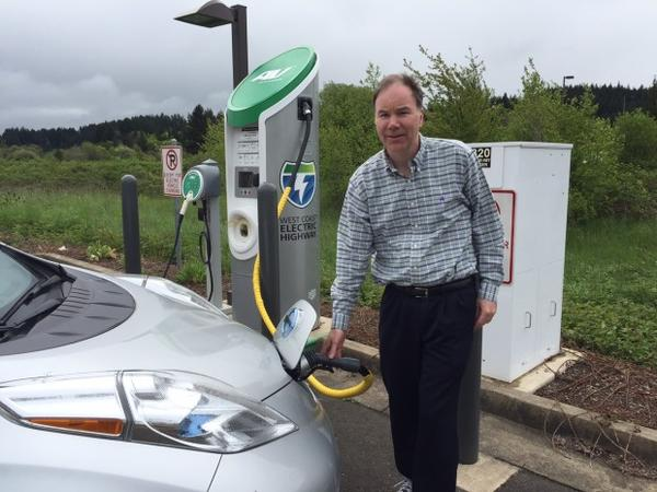 <p>Reporter Tom Banse recharging at a fast-charging station along the Oregon section of the West Coast Electric Highway.</p>