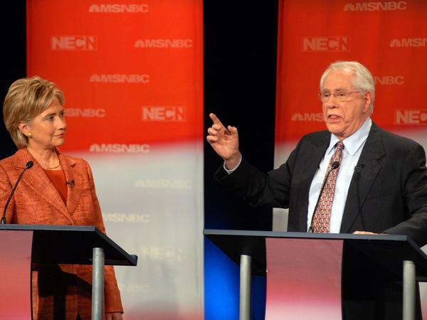Former U.S. Sen. Mike Gravel speaks during a September 2007 Democratic presidential debate as then-Sen. Hillary Clinton listens.