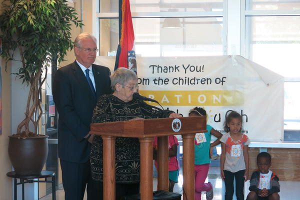 Operation Breakthrough's Sister Berta Sailer, center, introduces Missouri Gov. Jay Nixon. Nixon has vetoed a plan to cut off TANF benefits after 45 months.