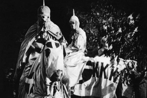 Actors dressed in full Ku Klux Klan regalia for scenes in 1915's <em>The Birth of a Nation</em>.