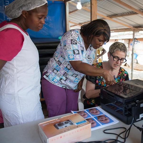 Heffernan prints photos at the Ebola treatment unit.