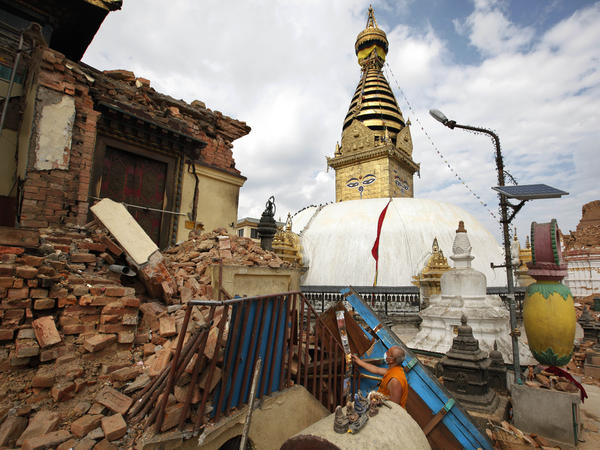 A Buddhist monk picks through a damaged monastery near the Swayambhunath stupa.