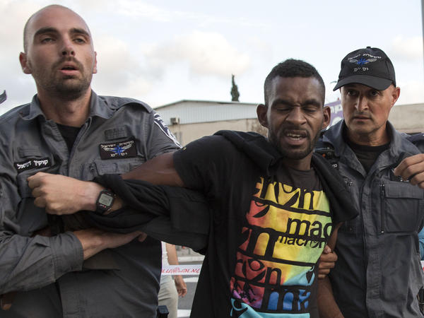 Israeli police officers detain an Ethiopian-Israeli during a demonstration Sunday in Tel Aviv.