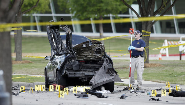 An FBI crime scene investigator documents evidence outside the Curtis Culwell Center on Monday in Garland, Texas.