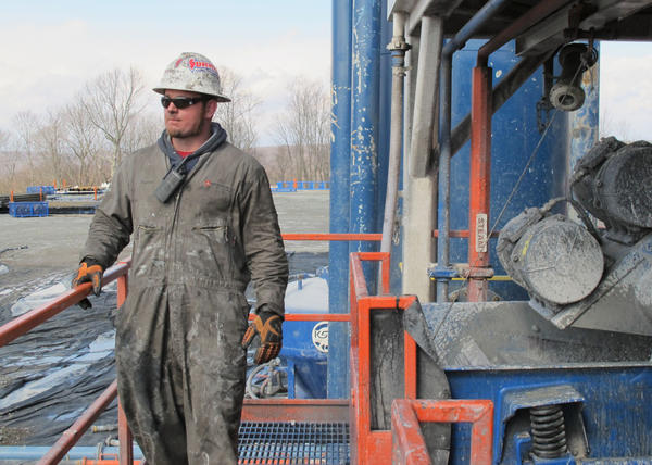 A worker stands by a natural gas well in Susquehanna County, Pa. (Susan Phillips/StateImpact Pennsylvania)