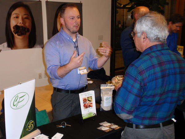 Cricket Flours Co-Founder Omar Ellis offers product samples in Portland.