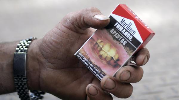 """<em>Fumando Apestas</em>: A cigarette package in Montevideo, Uruguay, warns that """"smoking, you stink."""""""