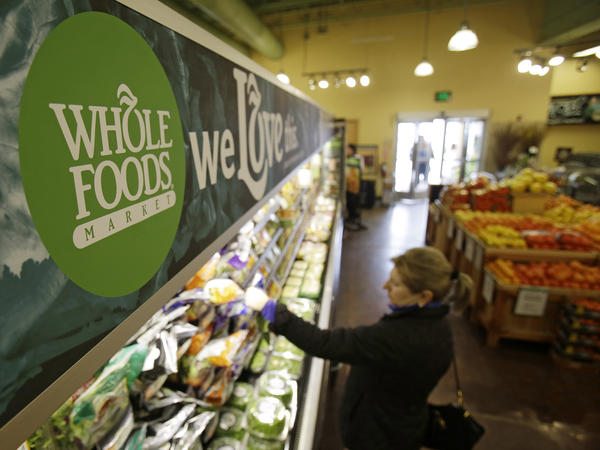 """A woman shops at the Whole Foods Market in Woodmere Village, Ohio, on March 27, 2014. The grocery chain has become known for its high-priced food and says its new chain will offer """"value prices."""""""