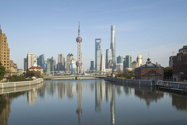 The twisting Shanghai Tower (right) is the world's second-tallest building and opens soon.