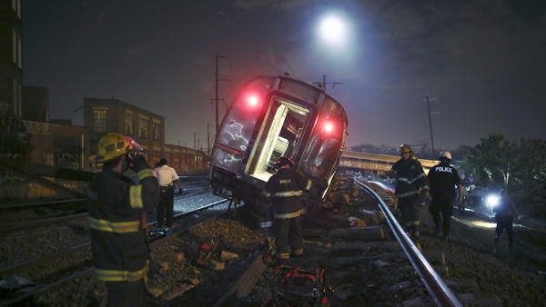Emergency personnel work the scene of the wreck of the Amtrak passenger train. All train service between Philadelphia and New York has been shut down following the crash.