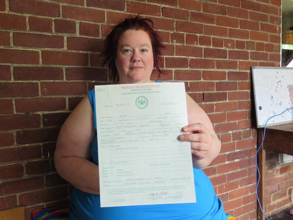 Stacy Emminger holds the death certificate for her son, Anthony, who was addicted to heroin. His death was marked as a multidrug toxicity in Pennsylvania.