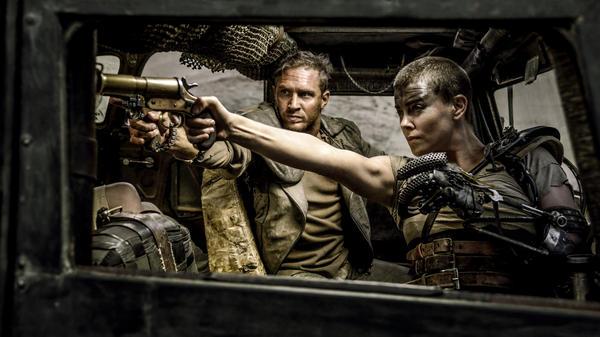 Charlize Theron as Furiosa, alongside Tom Hardy's Max Rockatansky in the new <em>Mad Max: Fury Road.</em>