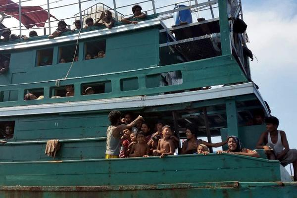 Migrants from Myanmar and Bangladesh are on an abandoned boat drifting in the Andaman Sea close to Malaysia and southern Thailand on Thursday.