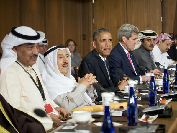 President Obama sits with Kuwaiti Emir Sheikh Sabah Al-Ahmad Al-Sabah, left center, Secretary of State John Kerry, right center, and other Gulf Cooperation Council leaders and delegations at Camp David, Md., on Thursday.