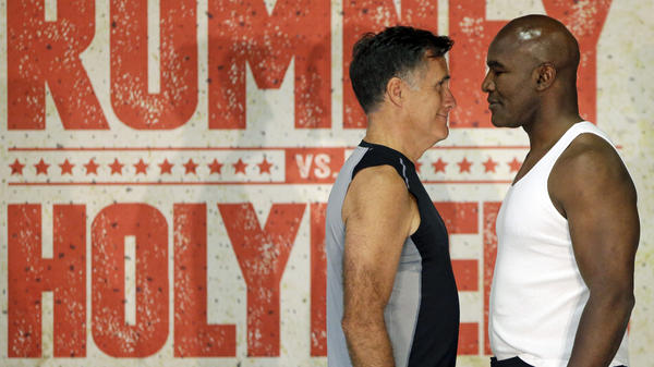 Former Republican presidential nominee Mitt Romney and former heavyweight boxing champion Evander Holyfield face each other during an official weigh-in Thursday, ahead of their charity fight Friday.