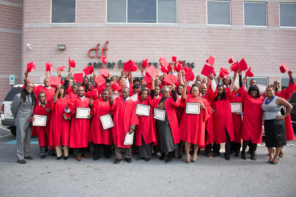 Graduates of a training program pose for a portrait after a completion ceremony at the Center for Urban Families.