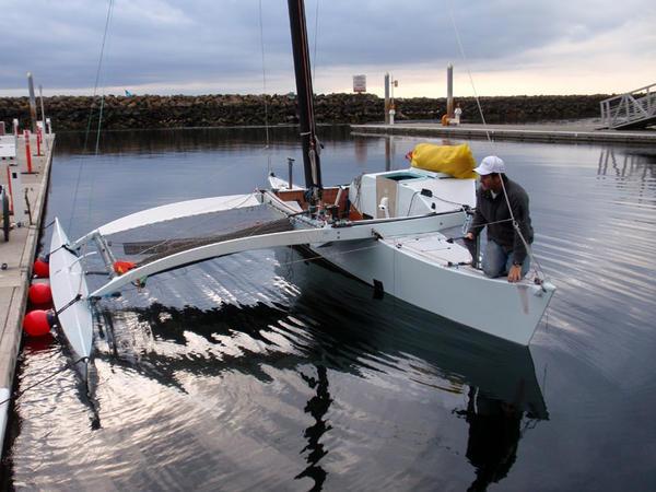 Joe Bersch prepping the Team Pure & Wild proa to sail to Ketchikan.