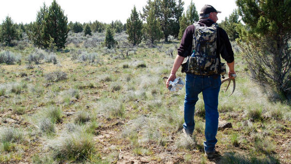 <p>Troy Capps carries deer antlers he found in Central Oregon.</p>