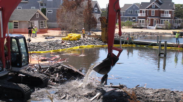 Demolition crews remove the last remains of a house that was destroyed by Superstorm Sandy, which battered parts of the East Coast, in 2013.