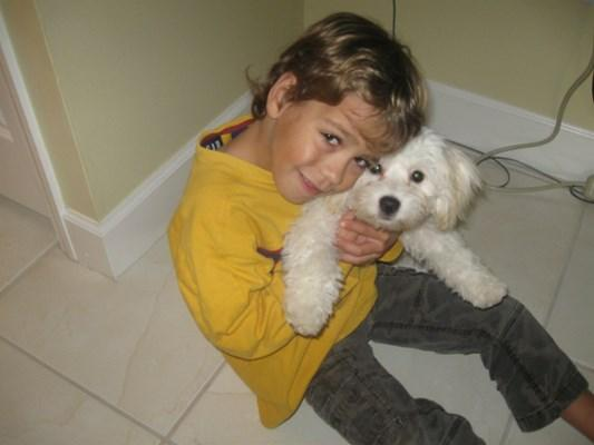 Justin Solnay with family poodle