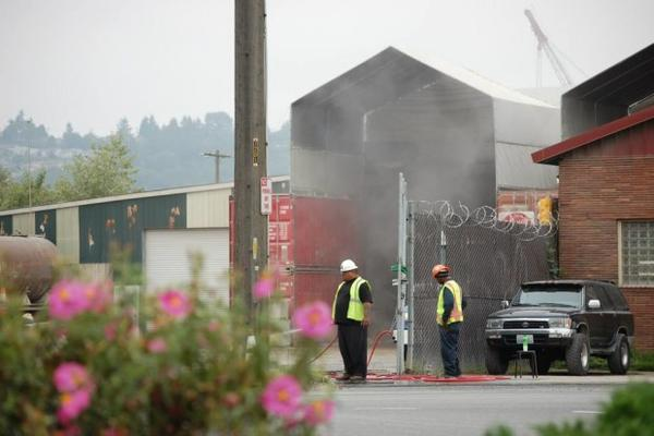 <p>Workers at CDL Recycle in the Seattle neighborhood of Georgetown. It's been the subject of complaints by neighbors who say it's putting out too much dust.</p>