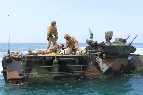 Sgt. Cassie McDole and another crew member have completed a casualty evacuation drill, pulling a 220-pound life-size dummy through the narrow hatch of the amphibious assault vehicle.