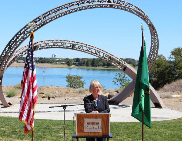 U.S. Senator Patty Murray speaks in front of the A 40-foot metal arch sculpture outside the REACH center in RIchland, Washington.